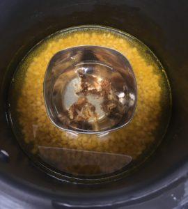 Dal and water in a pressure cooker