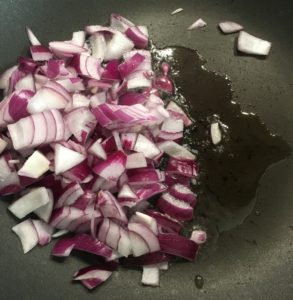 Frying the onion in a pan with oil