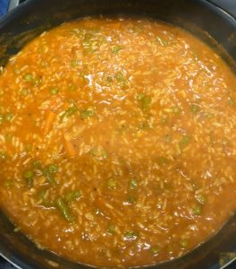 Simmering the bisi bele bath recipe  mixture for a few minutes