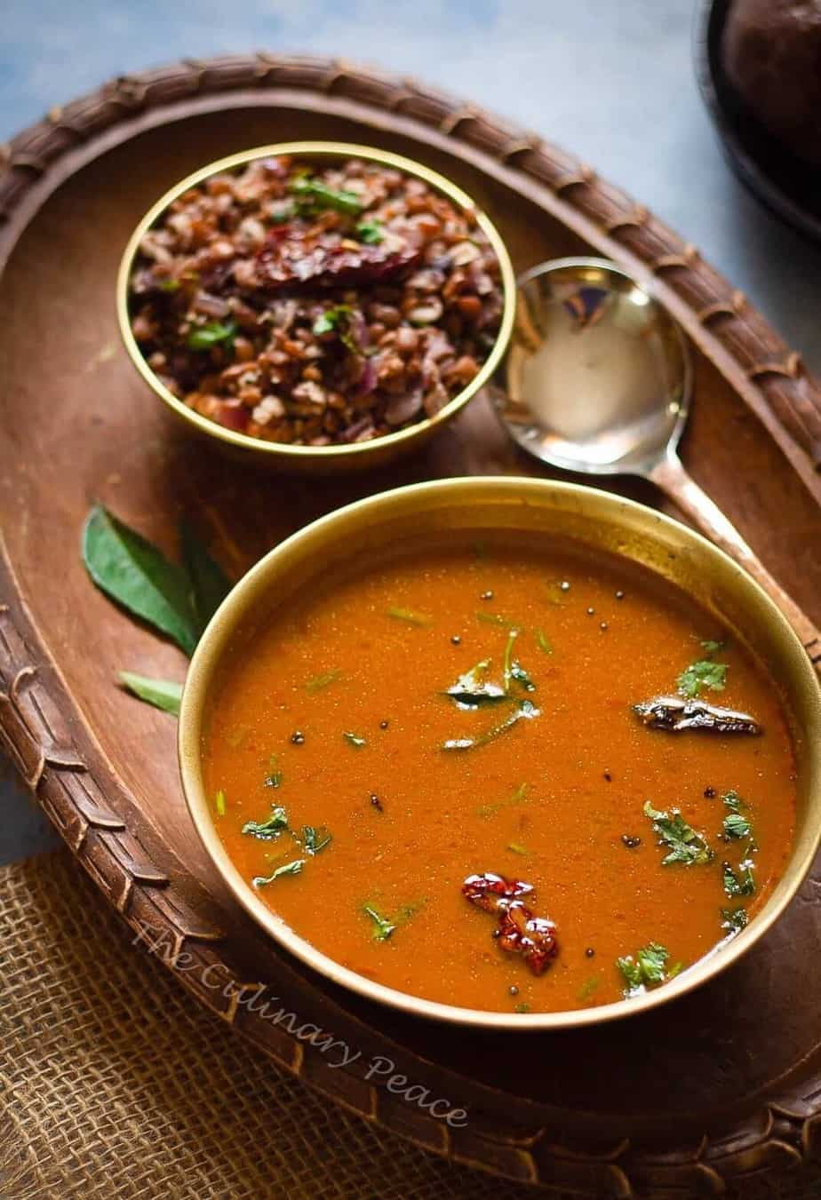 Kollu Rasam served in a bowl on a tray with a side and a spoon