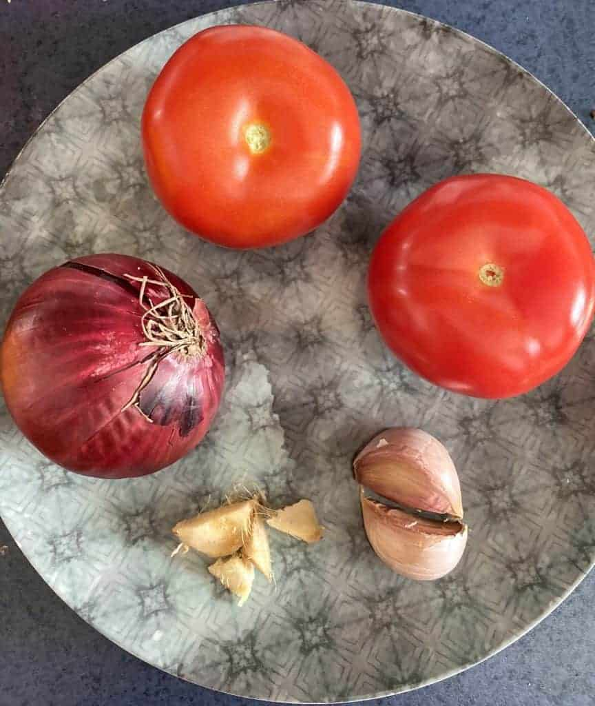 Tomatoes, onion and garlic, ready for chopping