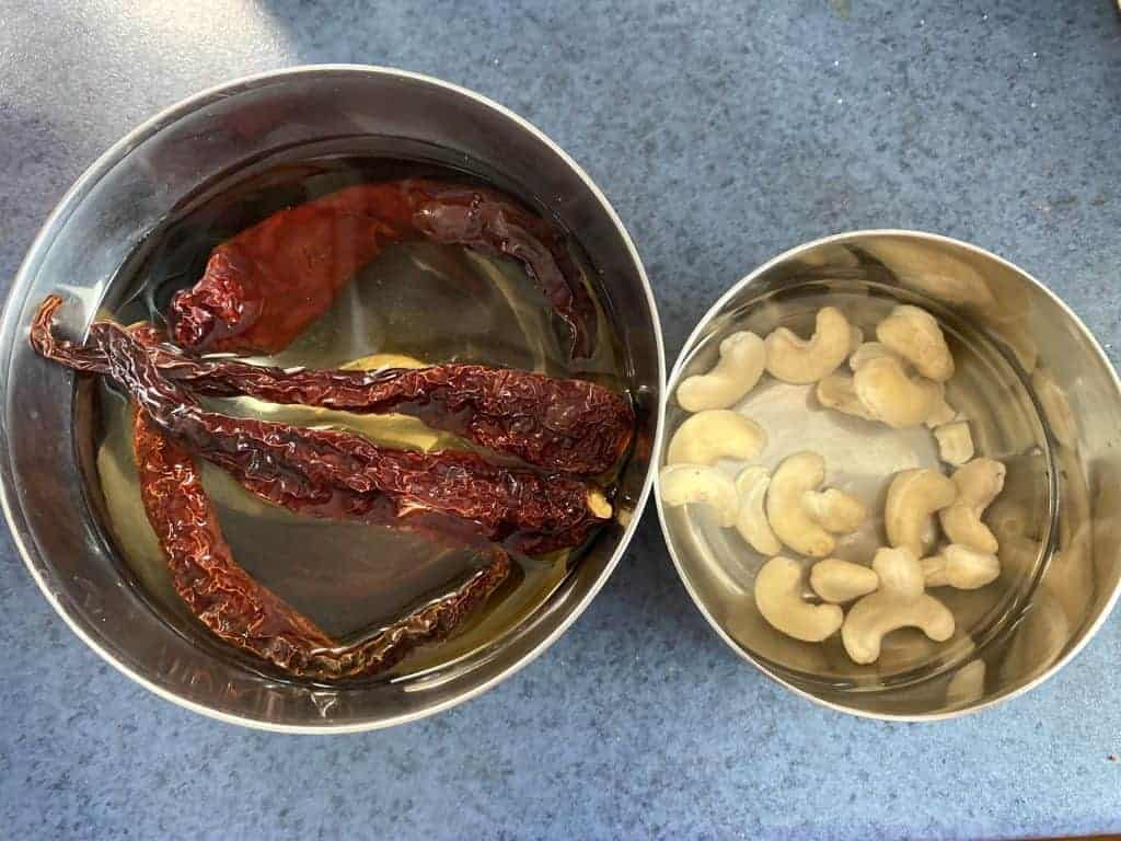 Cashews and Kashmiri red chilies ready for cooking