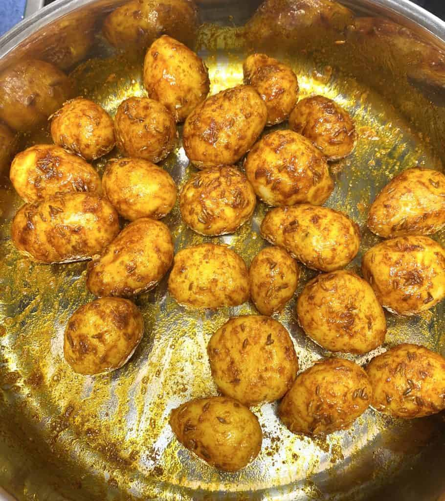 Dum Aloo is a spicy, creamy Indian curry made with baby potatoes