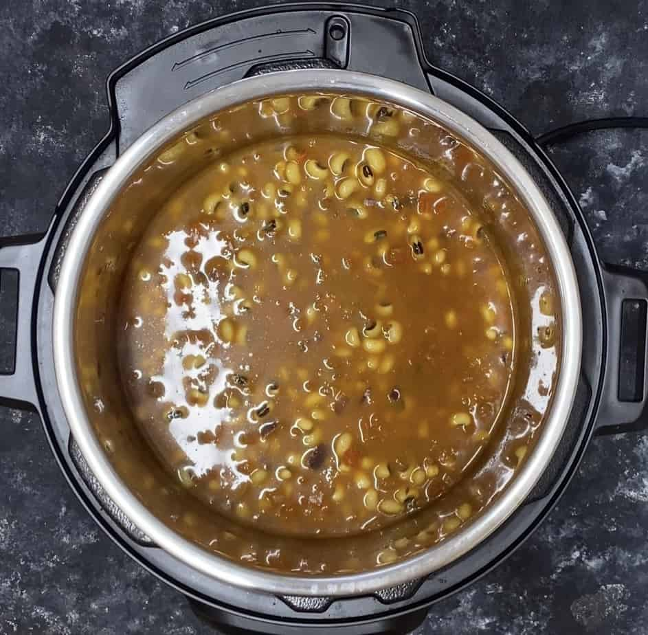 Adding soaked beans together with water