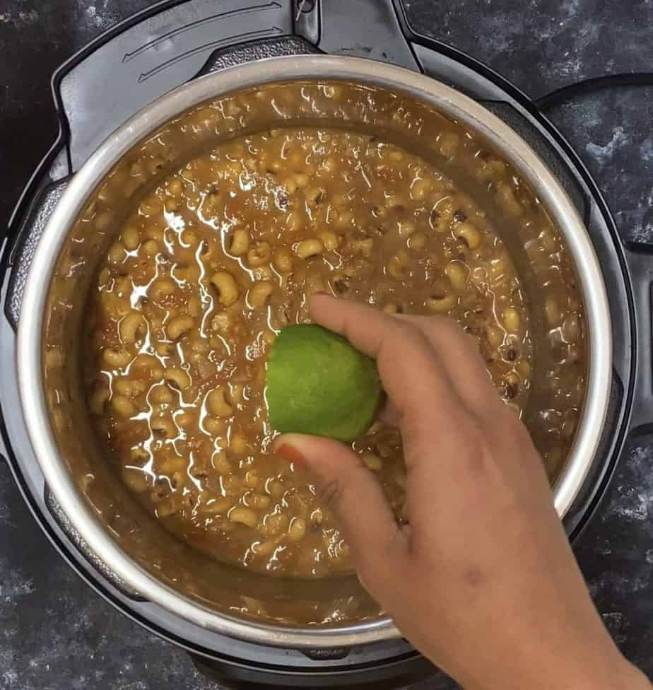Adding lime juice to the Instant Pot Black Eyed Peas Curry